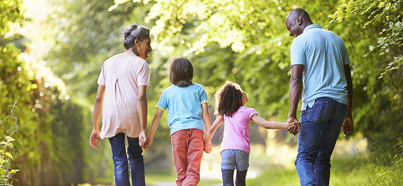 image of family walking holding hands