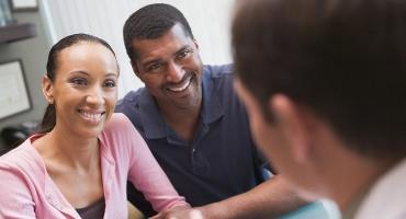 image of couple speaking with a specialist